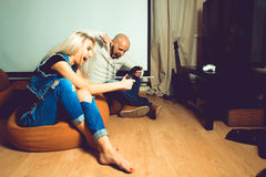 Angry couple playing computer games on tv Royalty Free Stock Photo