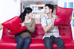 Angry couple on red sofa at home Stock Image