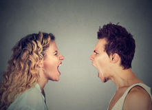 Angry couple screaming face to face. Stock Images