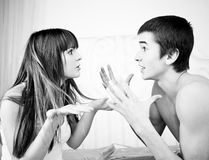 An angry couple shouting each other. Portrait of an angry couple shouting each other Stock Image