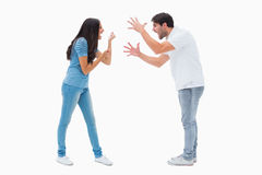 Angry couple shouting at each other Stock Images