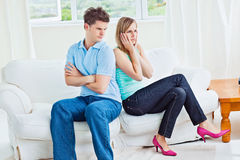 Angry couple sitting back to back. On the sofa at home Royalty Free Stock Photo