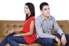 Angry couple sitting on the couch Royalty Free Stock Photo