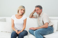 Angry couple sitting on sofa after a fight Stock Photo