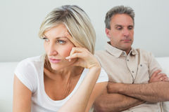 Angry couple sitting on sofa after a fight Royalty Free Stock Photography