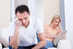Angry couple sitting on sofa Royalty Free Stock Image