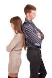 Angry couple standing back to back. Stock Photo