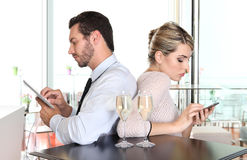 Angry couple turning their back on each other Royalty Free Stock Photo