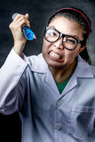 Angry crazy asian doctor with a syringe Royalty Free Stock Photo