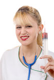 Angry crazy blond doctor with a syringe Stock Photos