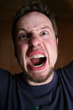 Angry, crazy man. Yelling at the viewer Royalty Free Stock Photography