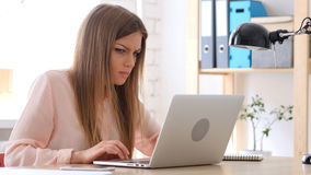 Angry Creative Woman Working on Laptop, Disturbed Royalty Free Stock Photos