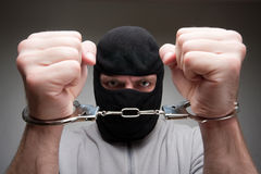 Angry criminal in handcuffs Royalty Free Stock Image