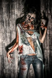 Angry cruel. Furious bloody zombie girl. Horror. Halloween Stock Image