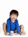 Angry crying toddler boy. Sitting with diaper. Disabled with cerebral palsy royalty free stock images