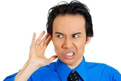 Angry curious man listening Stock Images