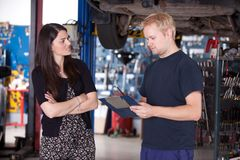 Angry Customer with Mechanic royalty free stock images