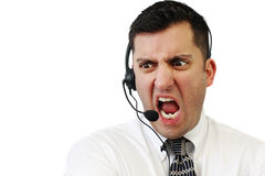 Angry Customer Service Man. A customer service agent yelling at his client isolated over white Stock Photos