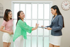 Angry customers that rejects to sing a contract. At office stock images