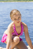 Angry cute girl in pink swimsuit Royalty Free Stock Photography