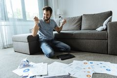 Angry desperate man sitting on his knees Stock Images