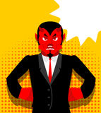 Angry devil. Satan is not happy. Angry red Demon. Lucifer is furious. Lord of Hell in pop art style. Bubble for text Stock Photos