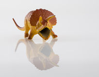 Angry dinosaur toy  on white Stock Photography