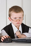 Angry director. Four year old boy playing angry director in his office stock image