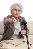 Angry disabled old woman pointing Stock Images
