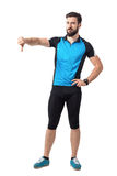 Angry disappointed sport bicyclist showing thumbs down hand gesture royalty free stock photo