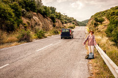 Angry and disappointed woman hitchhiker Royalty Free Stock Image