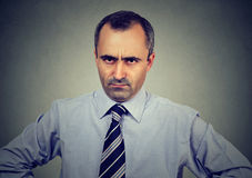 Angry displeased business man looking at camera Stock Image