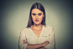 Angry displeased woman on gray background Stock Images