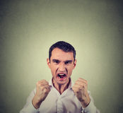 Angry displeased young man screaming Royalty Free Stock Photos
