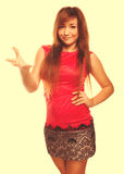 Angry dissatisfied young woman haired girl in red dress emotion Royalty Free Stock Photos