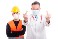 Angry doctor and constructor showing double middle finger Royalty Free Stock Photography