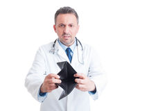Angry doctor or medic showing empty wallet Royalty Free Stock Photos