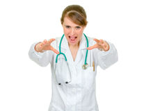Angry doctor woman wants to catch you Royalty Free Stock Photos