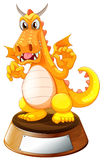 An angry dragon above the trophy Royalty Free Stock Image
