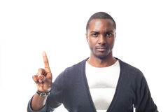 Angry dressed casual afro-american man with white t-shirt and gesturing with finger. Stock Photo