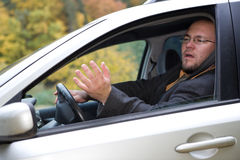 Angry driver. Angry man driving by car Royalty Free Stock Photo