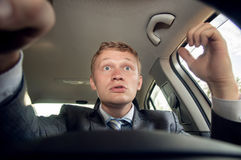 Angry driver behind the wheel of a car while driving Stock Image