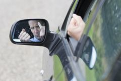 Angry driver giving finger Stock Photography