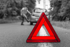 Angry driver kicking the tires on broken car Royalty Free Stock Images
