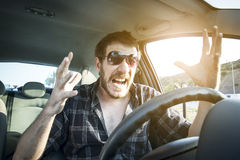 Angry Driver. Portrait of angry driver on traffic jam stock images
