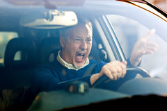 Angry driver. Shouting in his car stock image