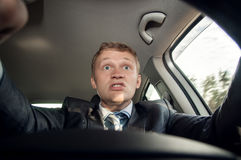 Angry driver shouting sitting behind the wheel of of the car Royalty Free Stock Image