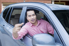 Angry driver shows middle finger Stock Photos