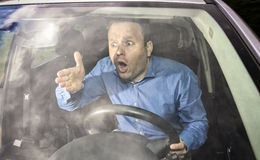 Angry driver. Yelling on some other driver during driving Royalty Free Stock Photos