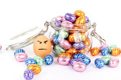 Angry egg between chocolate easter eggs Royalty Free Stock Image